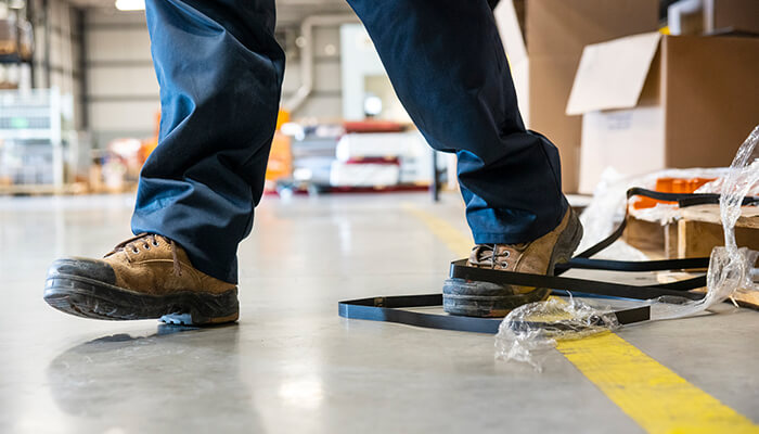Hard plastic ties wrapped around worker's shoe